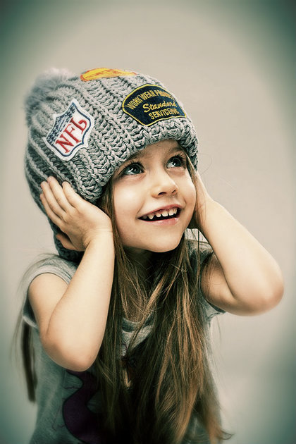 little girl with a cap