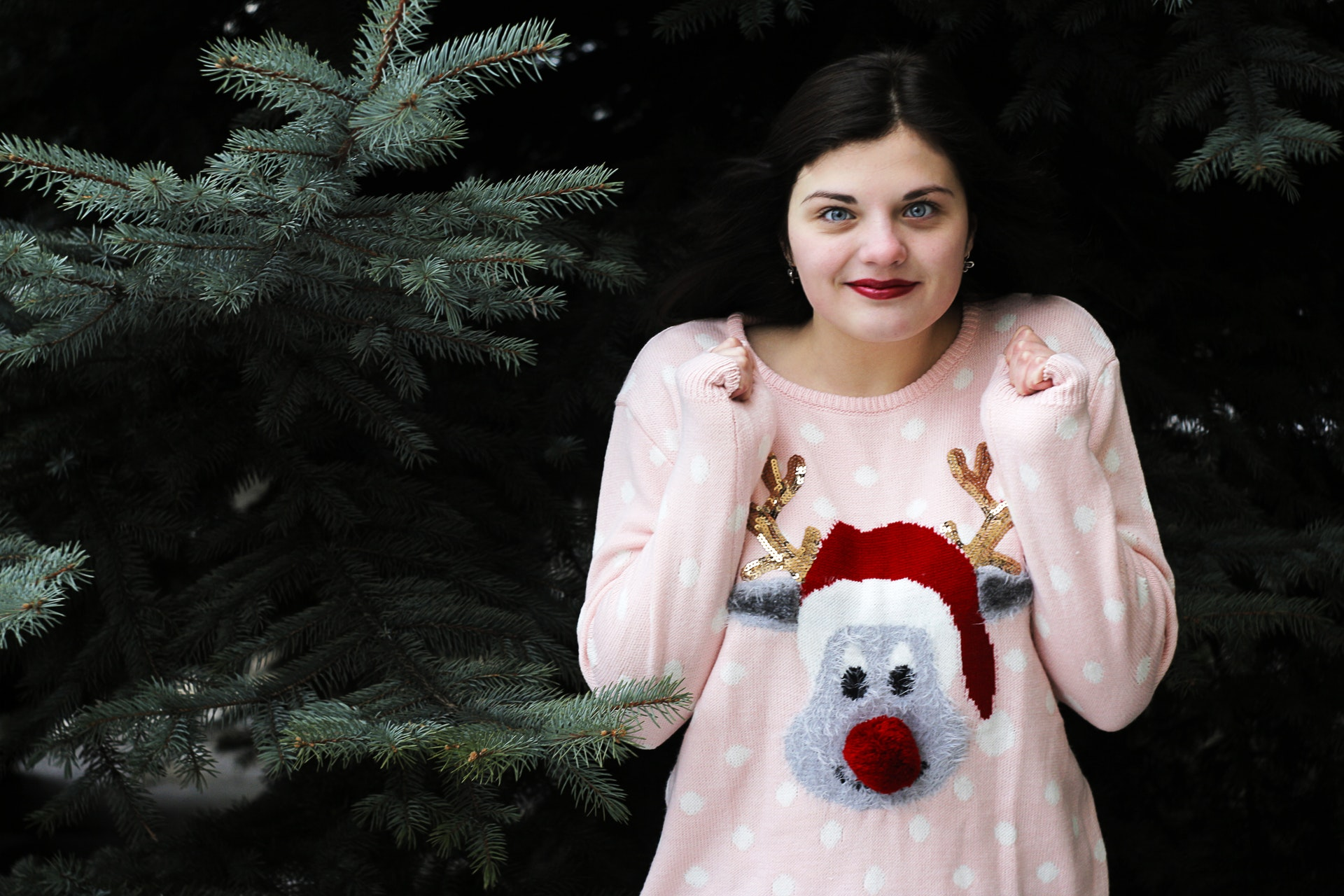 girl wearing a christmas sweater